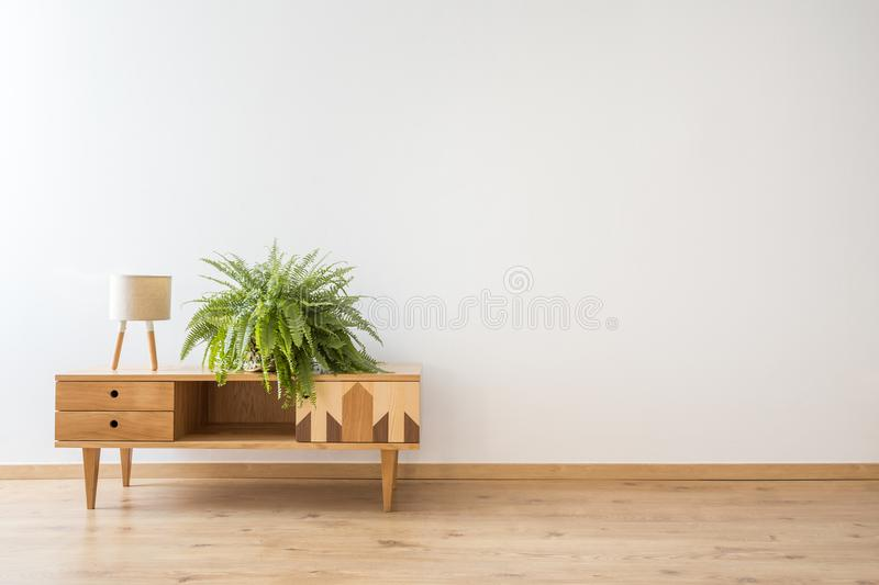 Living room with wooden cupboard stock images