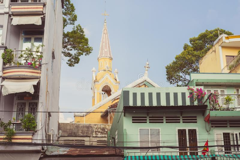 Living in Saigon: picturesque balconies of residential houses and Cha Tam Church stock images