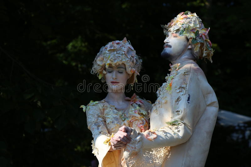 Living statues - young couple enjoying royalty free stock photography