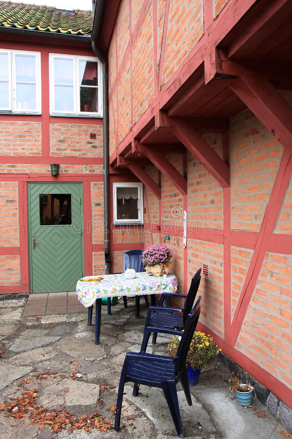 Living at Stortorget in Ystad, Sweden. Old framework or half-timbered houses and little seat in the historical town of Ystad in the south of Sweden. After the stock photo