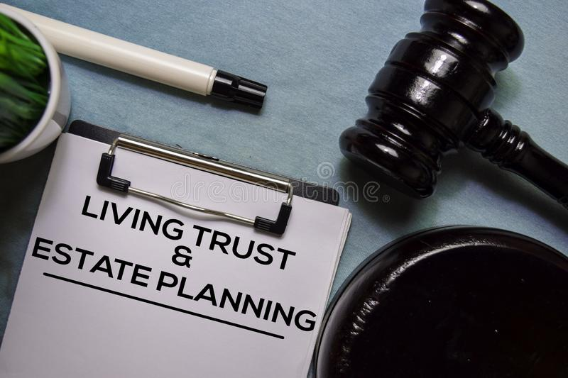 Living trust and Estate Planning text on Document form and Gavel  on office desk. stock photography