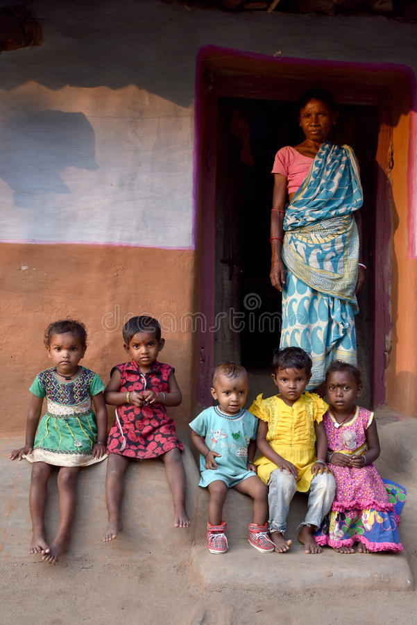 Living In Village. A group of tribal children with a woman posed in Purulia-West Bengal stock photography