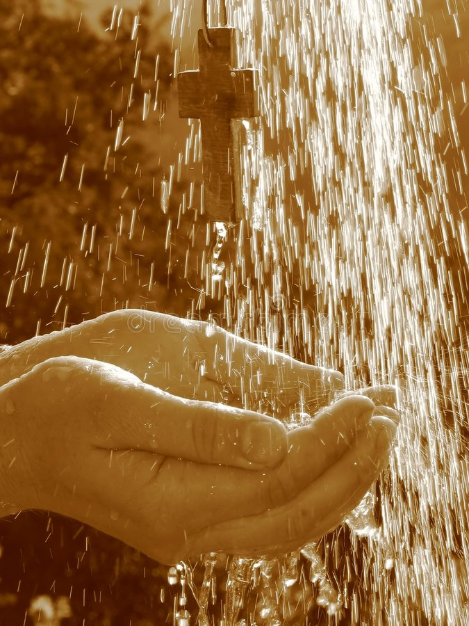 Living water - Cross in shower royalty free stock image