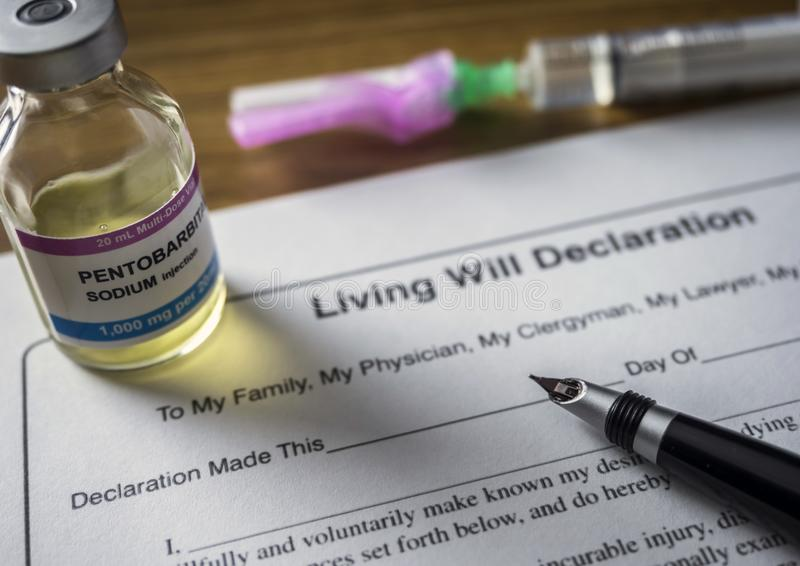 Living will declaration form Next to a vial of pentobarbital sodium to proceed to euthanasia. Conceptual image royalty free stock images