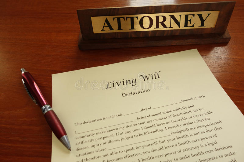 Living will. A living will document with pen and attorney name plate stock images