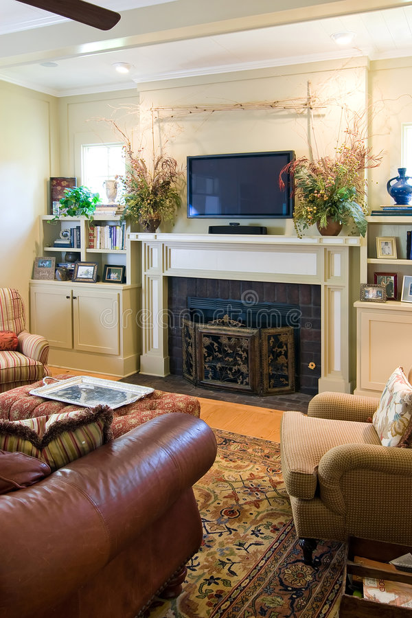 Livingroom with fireplace and tv royalty free stock images
