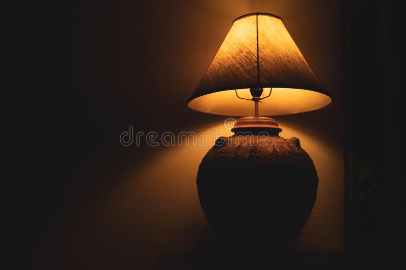 Livingroom lamp at night with dark background royalty free stock photos