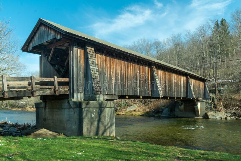 Livingston Manor, NY / United States - April 19, 2020: A three-quarter view of the Livingston Manor Covered Bridge spanning the. A three-quarter view of the royalty free stock image