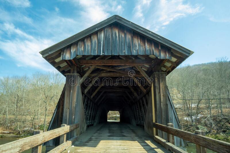 Livingston Manor, NY / United States - April 19, 2020: A view of the entrance to the Livingston Manor Covered Bridge. A view of the entrance to the Livingston royalty free stock photo