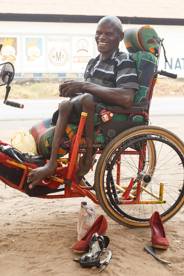 Free LIVINGSTONE - OCTOBER 14 2013: Local Disabled Man With An Adapted Wheelchair Sets Up Successful Shoe Repair Business In Stock Photography - 37005462