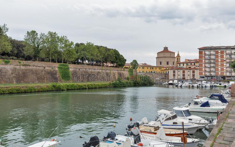 Livorno cityscape with canal and New Fortress, Italy. Livorno cityscape with canal, New Fortress and Church of St. Catherine, Italy stock photos