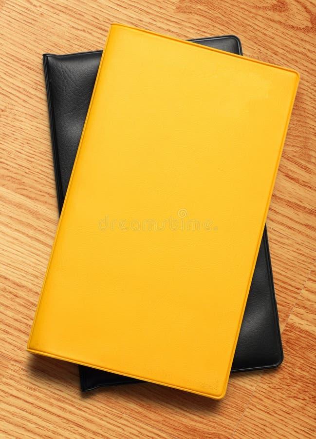 Livre blanc jaune photo stock