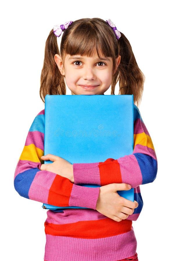 Livre d'abig de fixation de petite fille image libre de droits