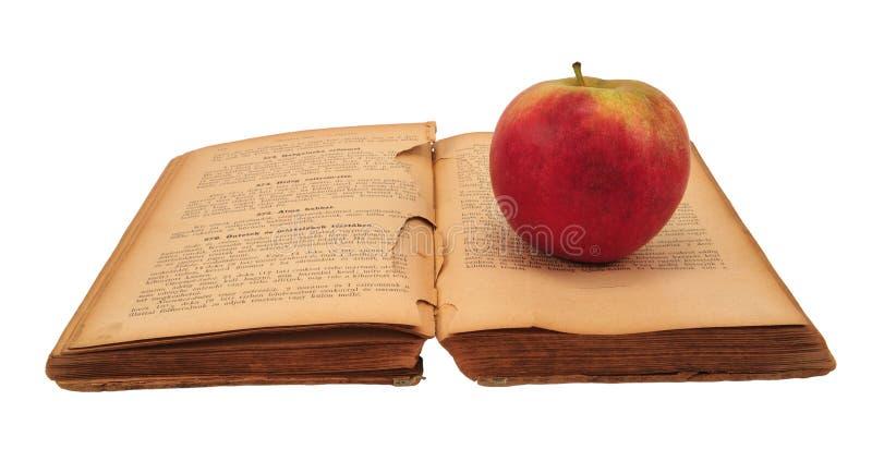 Livre de cuisine avec la pomme photo stock