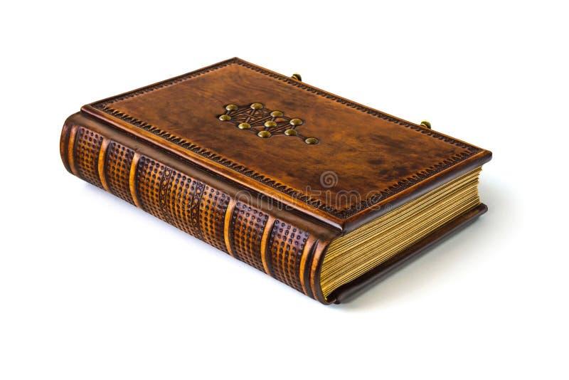 Livre en cuir avec l'arbre du symbole de la vie photographie stock libre de droits