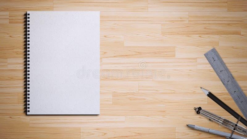 Livre en spirale avec le stylo, le crayon, la règle et la boussole photos stock