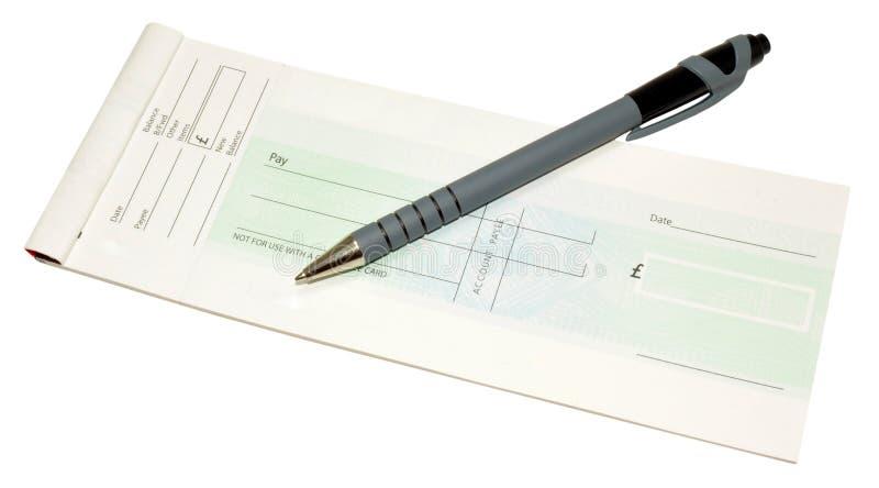 Livre et stylo de chèque photos libres de droits