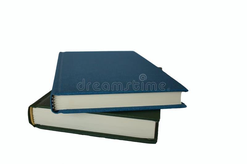 livres bleus et verts d'isolement photos stock
