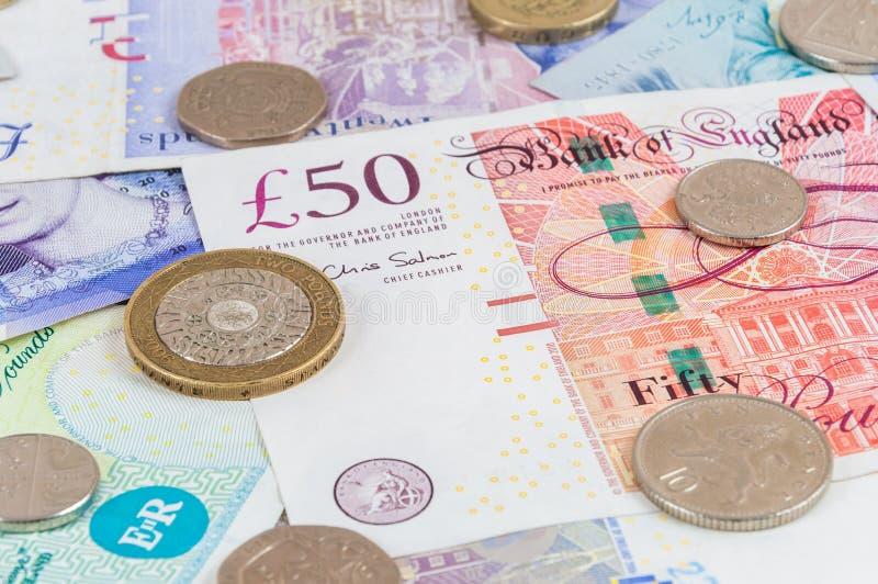 Livres britanniques de billets de banque et fond de pièces de monnaie photographie stock libre de droits