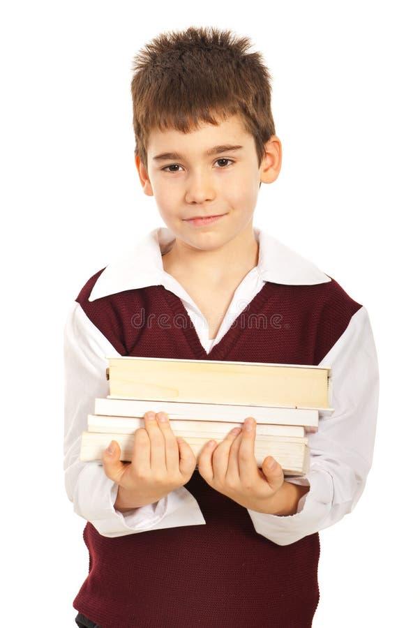 Livres de transport de garçon d'étudiant photos stock