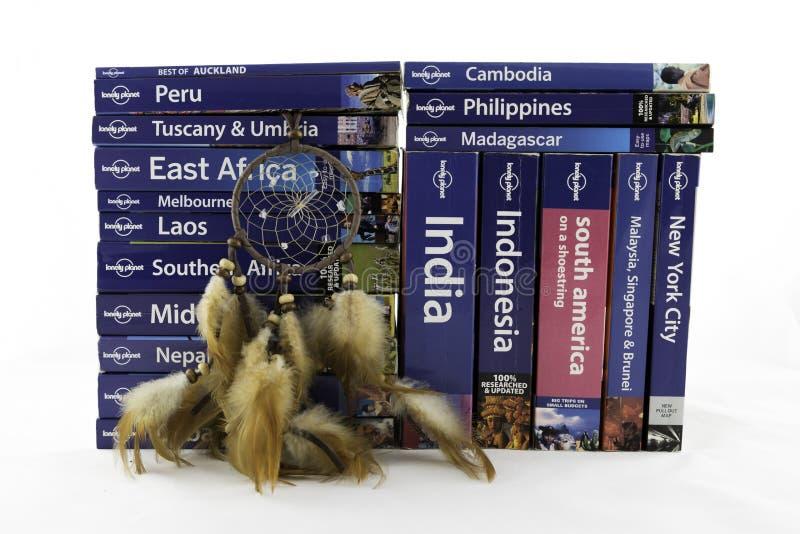 Livres de voyage et receveur rêveur photographie stock libre de droits