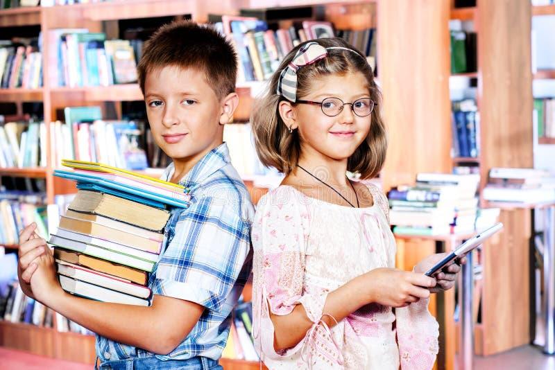 Livres et e-lecteur photo libre de droits