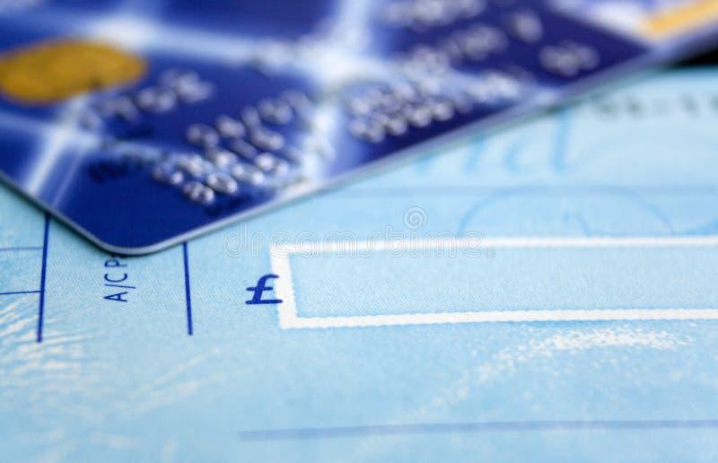 Livro & cartão de cheque fotografia de stock