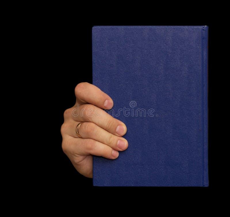 Livro azul à disposição foto de stock