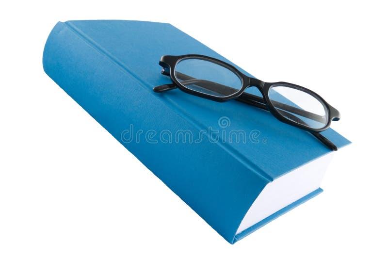 Livro azul e vidros pretos imagem de stock