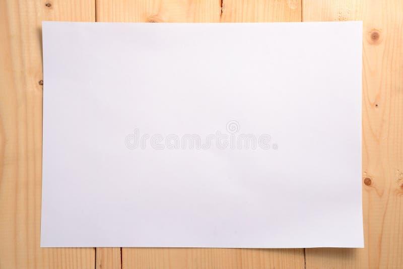 Livro Branco no assoalho de madeira imagem de stock royalty free