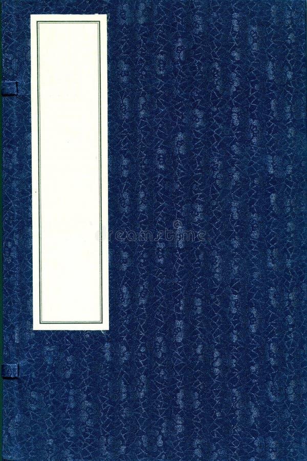 Livro chinês antigo com tampa de seda modelada fotografia de stock royalty free