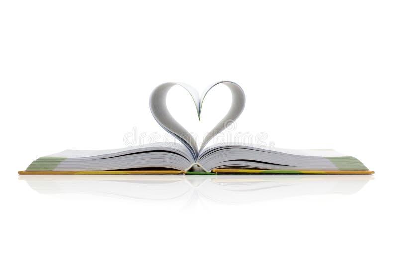 Livro com o coração fotografia de stock