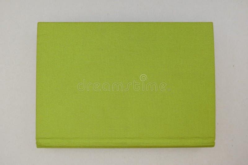 Livro com tampa de tela verde fotos de stock