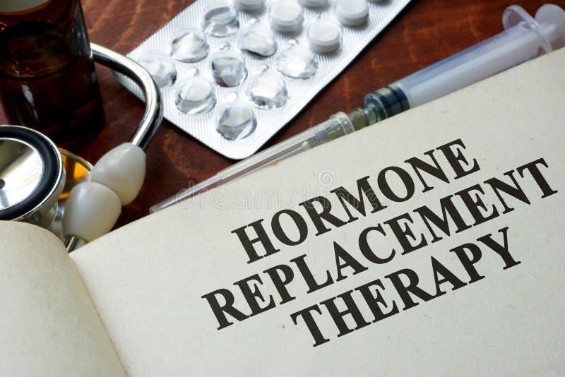 Livro com terapêutica hormonal de substituição das palavras fotografia de stock royalty free