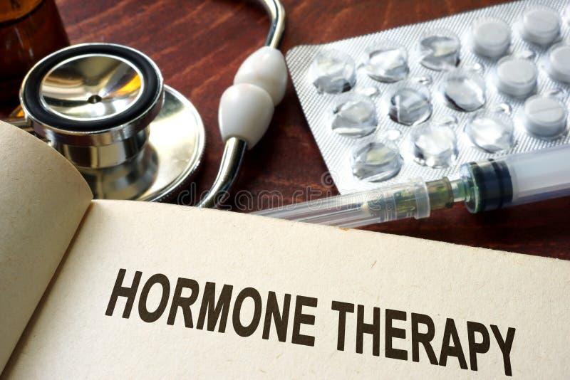 Livro com terapia da hormona das palavras imagens de stock royalty free