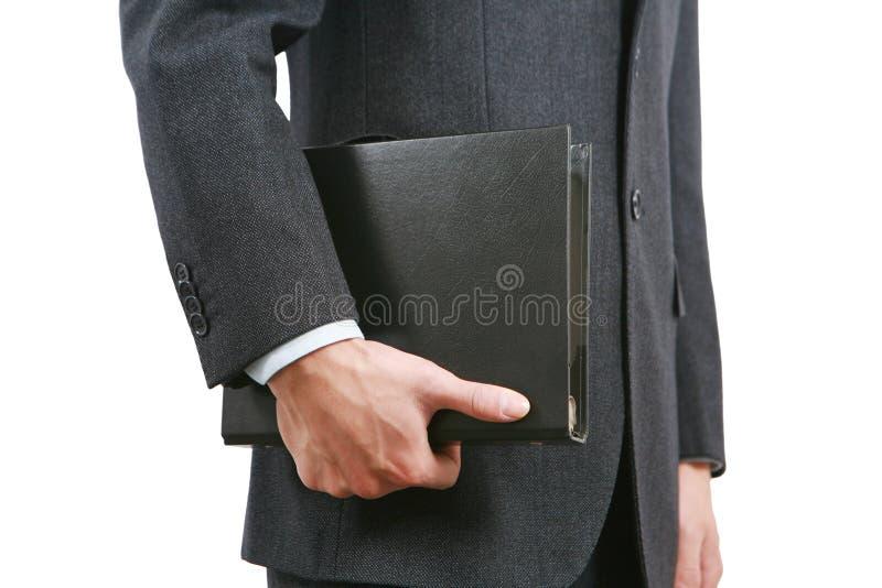 Livro da terra arrendada do homem de negócio foto de stock