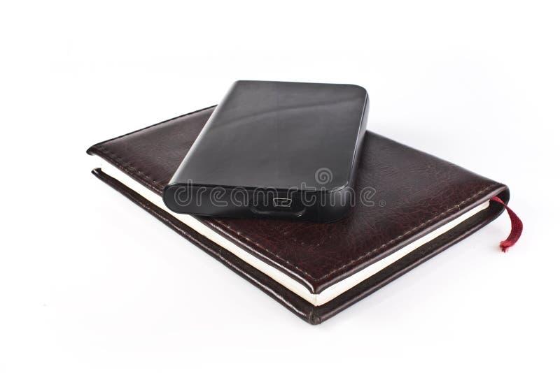 Livro de couro clássico e driv duro portátil moderno fotos de stock