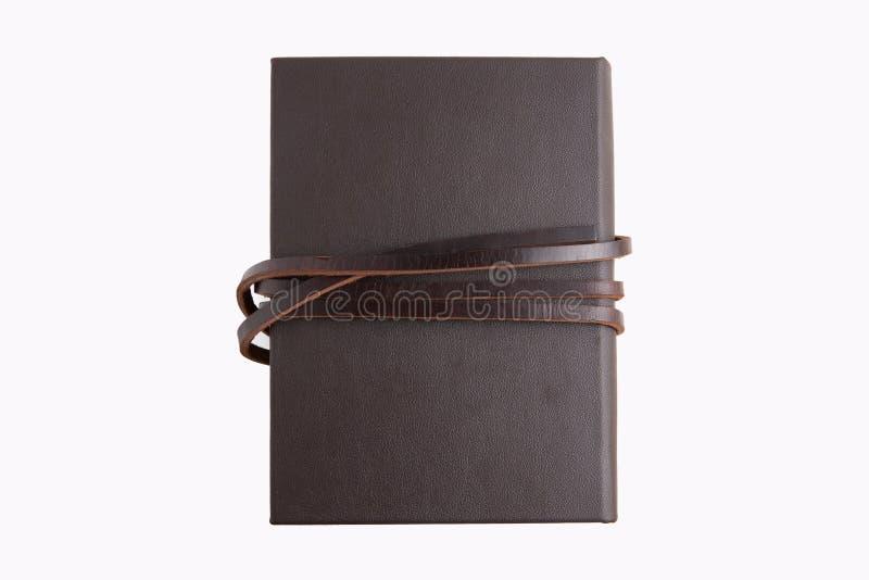 Livro de couro marrom secreto com fundo branco fotos de stock royalty free