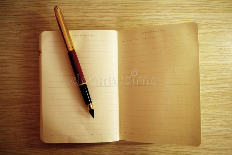 Livro de nota do diário fotografia de stock royalty free