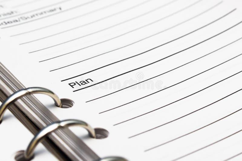 Livro de nota do negócio do plano imagem de stock