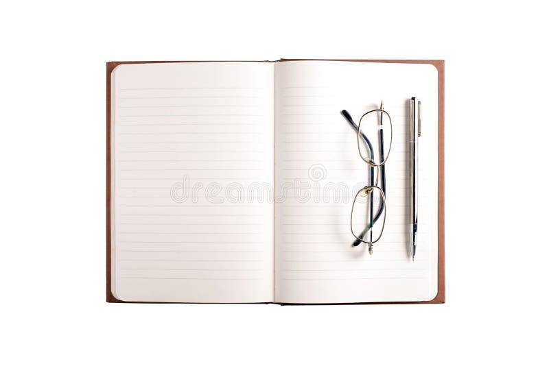 Livro de nota, vidros do olho e pena vazios imagens de stock royalty free