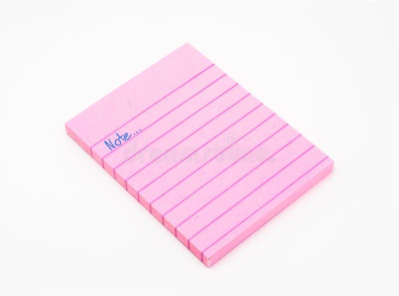 Livro do papel de nota cor-de-rosa fotografia de stock