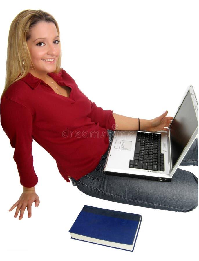 Livro do portátil da mulher nova imagem de stock royalty free