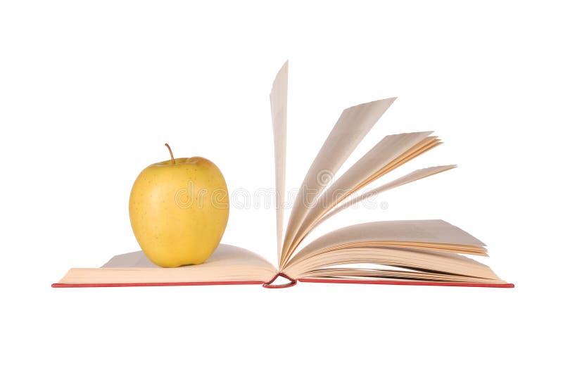 Livro e Apple imagem de stock