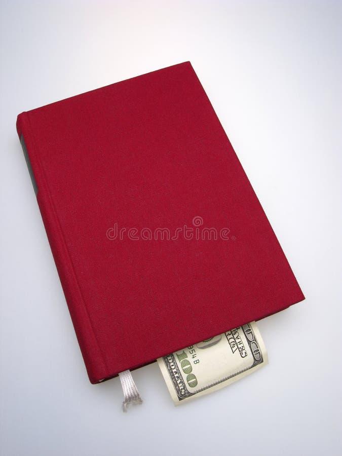 Livro e dinheiro imagem de stock