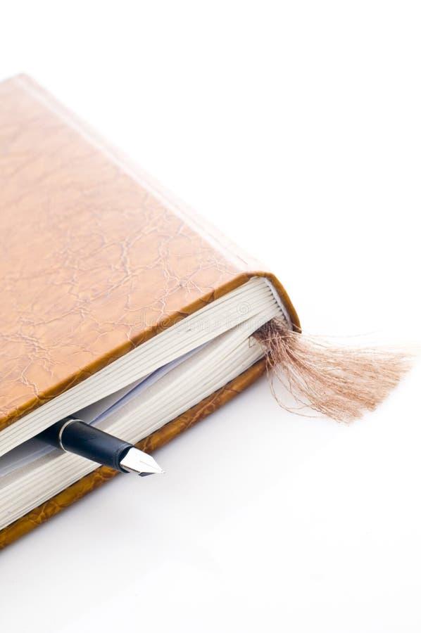 Livro e pena fotografia de stock royalty free