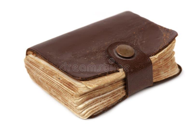 Livro velho de Leatherbound no branco fotografia de stock