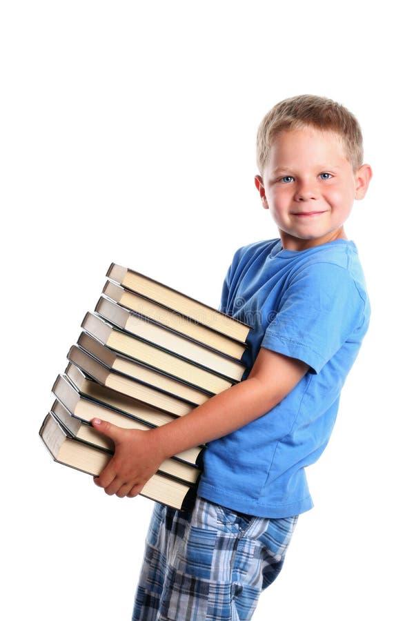 Livros carreg da criança feliz imagens de stock