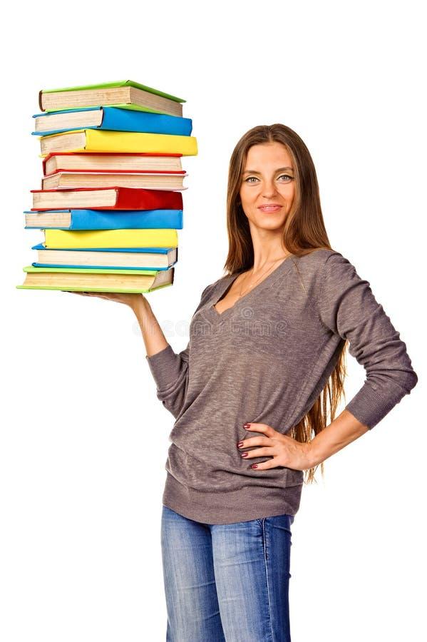 Livros da cor da pilha da terra arrendada da menina do estudante imagens de stock royalty free