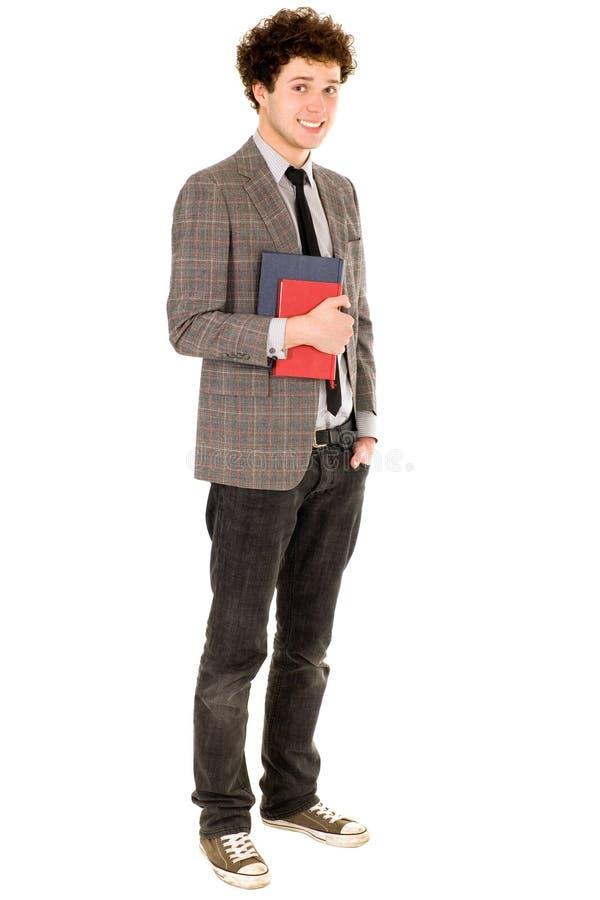 Livros da terra arrendada do estudante masculino fotografia de stock royalty free